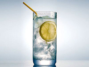 Ice water in lemon can substitute for the appearance of gin and tonic or vodka. This drink's coolness helps dissipate redness due to overheating during social gatherings.